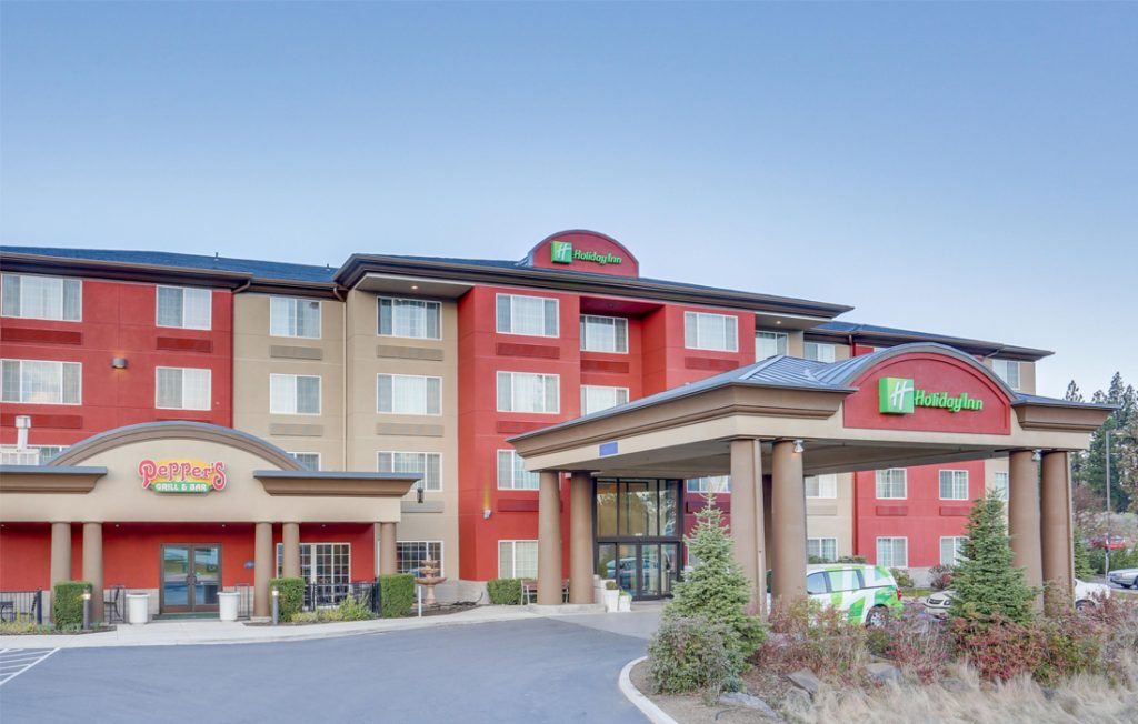 Enterance of Holiday Inn hotel with Peppers Grill and Bar pictured in the corner