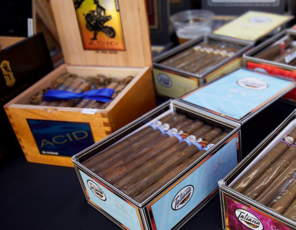 Boxes on boxes of cigars sitting on a table