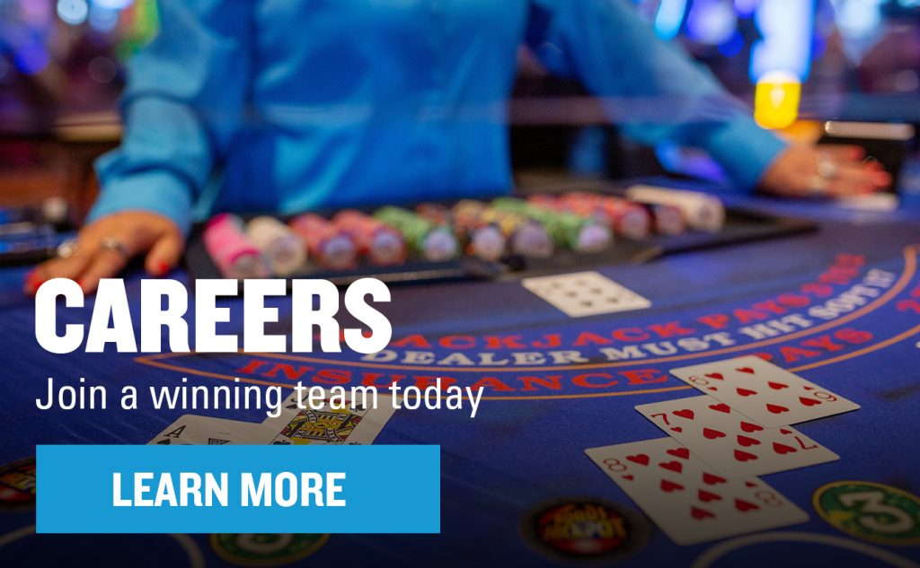 """Dealer on black jack table with graphics saying """"Careers. Join a winning team today"""" and a button that says """"Learn More"""""""