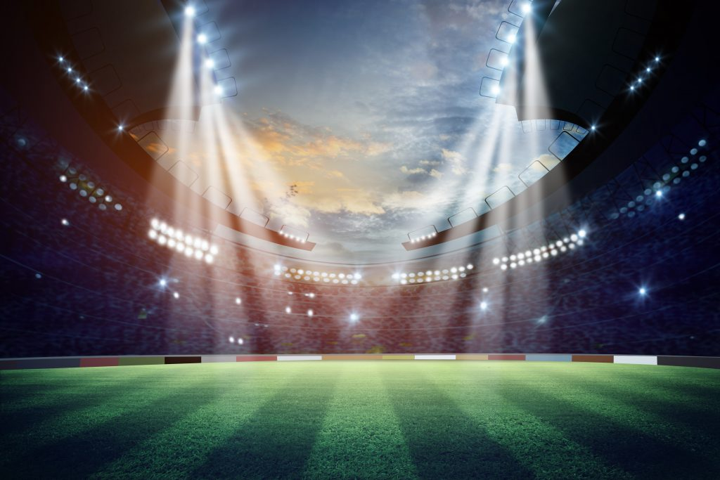 Lights at night in a stadium with a field 3D render